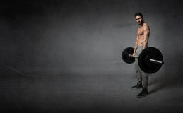Crossfit excercise wiht weights. Empty space Royalty Free Stock Photo