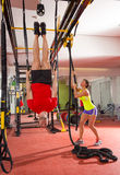 Crossfit fitness dip ring man workout upside down at gym. Crossfit fitness dip ring men workout upside down at gym dipping ans women with rope Stock Photos