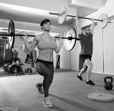 Crossfit fitness gym weight lifting bar group. Crossfit fitness gym weight lifting bar by women and men group workout Royalty Free Stock Image