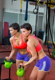 Crossfit fitness lifting Kettlebell woman at mirror workout Stock Photos