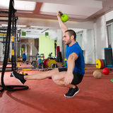 Crossfit fitness man balance Kettlebells with one leg Stock Photo