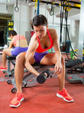 Crossfit fitness weight lifting Dumbbell woman at mirror Stock Images