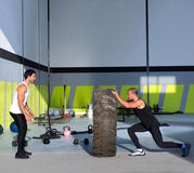 Crossfit flip tires men flipping each other Stock Photos