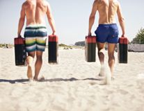 Crossfit Games. Two men running with jerry cans as a part of crossfit games Stock Image