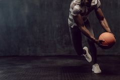 Crossfit guy training with basketball. Athletic man training with a basketball. Man working out holding a basketball in hand royalty free stock photography