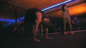 Crossfit gym. group fitness in the gym. Sports, fitness teamwork. Small fit group, crossfit team of athletes is working