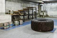 Crossfit gym interior. Photo of crossfit gym interior with the usual items for strenuous exercise Stock Image