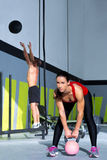 Crossfit gym Kettlebell woman and wall ball man Stock Photo