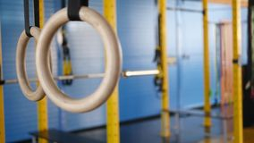 Crossfit gymnastic rings in the hall sunny day.  stock video
