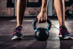 Crossfit kettlebell training. In gym Royalty Free Stock Image