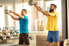 Crossfit kettlebell training in gym Royalty Free Stock Photos