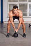Crossfit - kettlebell training man in a gym Royalty Free Stock Photography