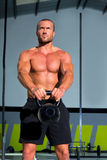 Crossfit Kettlebells swing exercise man workout Royalty Free Stock Images