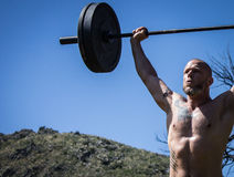 CrossFit Level 1 Trainer Performing Barbell Snatch Stock Photography
