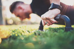 Crossfit lifestyle concept.Closeup view of male hand while doing pushups in the park on the sunny morning.Training. Outdoors.Fit shirtless male fitness healthy stock image