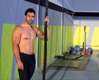 Crossfit man with climbing rope relaxed at gym Stock Photo