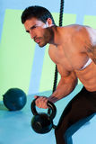 Crossfit man lifting kettlebell workout exercise Stock Photo