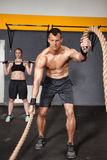 Crossfit man swinging rope Royalty Free Stock Images