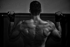 Crossfit pull up fitness exercise - back of a man Royalty Free Stock Image