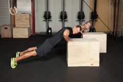 Crossfit push up exercise on a box Stock Photo