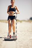 Crossfit Sled Pull. Crossfit exercise: Pulling a sled on sand Stock Photo