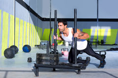 Crossfit sled push man pushing weights workout. Exercise royalty free stock photography