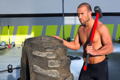 Crossfit sledge hammer man at gym relaxed Royalty Free Stock Photos