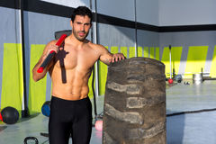 Crossfit sledge hammer man at gym relaxed Royalty Free Stock Images