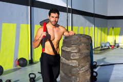 Crossfit sledge hammer man at gym relaxed Royalty Free Stock Photography