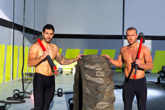Crossfit sledge hammer men workout Royalty Free Stock Photo