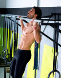 Crossfit toes to bar man pull-ups 2 bars workout Royalty Free Stock Photo