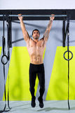 Crossfit toes to bar man pull-ups 2 bars workout. Exercise at gym Royalty Free Stock Photo