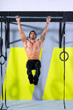 Crossfit toes to bar man pull-ups 2 bars workout. Exercise at gym Stock Photo