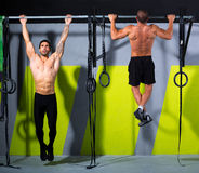 Crossfit toes to bar men pull-ups 2 bars workout Royalty Free Stock Photography