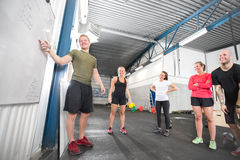 Crossfit training course. Crossfit instructor going through today's training plan Royalty Free Stock Images