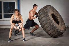 Crossfit training - man flipping tire Stock Image