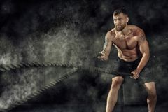 Crossfit training. Ropes. Crossfit training. Man working out with battle ropes at gym royalty free stock photos