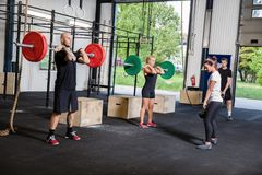 Crossfit training with weights and kettlebells. A group trains at a crossfit center. Weight workout at the gym Royalty Free Stock Photography