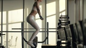 Crossfit woman jumping on platform on fitness training in gym club. Sports woman jumping on crossfit training in modern fitness club stock footage