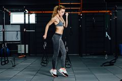 Crossfit woman standing with her front in the gym. Fitness woman, trained body, fitness model. Bodybuilder woman in the gym. Perfect fitness woman sexy Stock Image