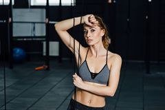 Crossfit woman standing with her front in the gym. Fitness woman, trained body, fitness model. Bodybuilder woman in the gym. Perfect fitness woman sexy Royalty Free Stock Images
