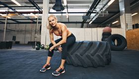 Crossfit woman taking break at gym Stock Photo