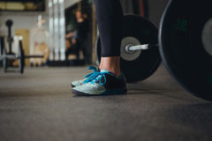 Crossfit Women. Cropped image of a crossfit man working out royalty free stock image