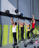 Crossfit workout people group with wall balls and rope Royalty Free Stock Image
