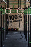 Crossfit zone on gym. Photo of crossfit zone with gymnastic circles on gym Stock Photography