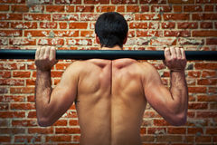 Crossfitter Training in the Gym with an Axle Bar Stock Image