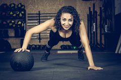 Crossfitter training hard daily wod ball stock images