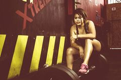 Crossfitter training hard daily wod deadlifting resting stock photo