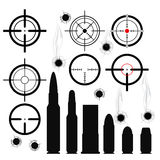 Crosshairs (gun sights), cartridges and bullet holes. Crosshairs (gun sights), bullet cartridges and bullet holes Royalty Free Stock Image