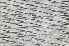 Crosshatched scratched concrete Stock Photos